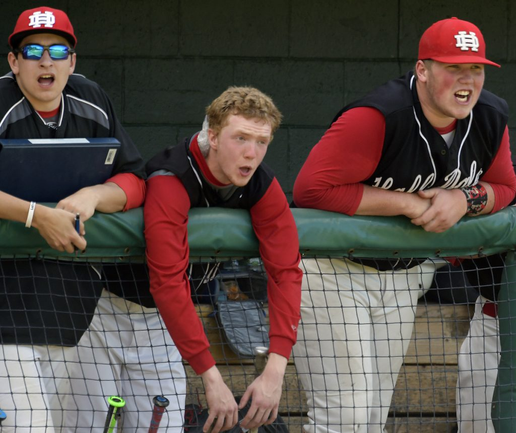 Staff photo by Andy Molloy   Hall-Dale players Cole Lockhart, right, Dean Jackman and Cole Perry cheer on their team during the Class C South championship game Tuesday against Maranacook at St. Joseph's College in Standish.