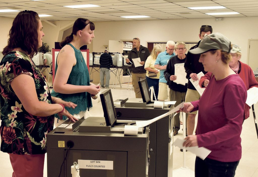 Winslow resident Michelle Dugal casts her ballot at the VFW in Winslow on Tuesday.