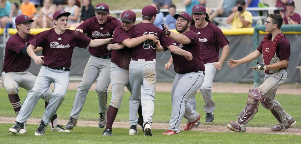 Richmond players celebrate defeating Searsport after a Class D South regional final game Wednesday in Standish.