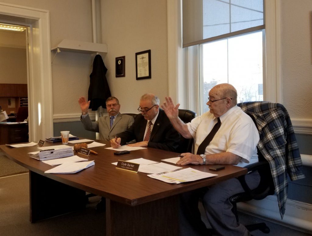 The Franklin County Budget Committee overrode suggestion from the Franklin County commissioners — from left, Terry Brann, Charles Webster and Clyde Barker — to add $10,000 for communications to the budget.
