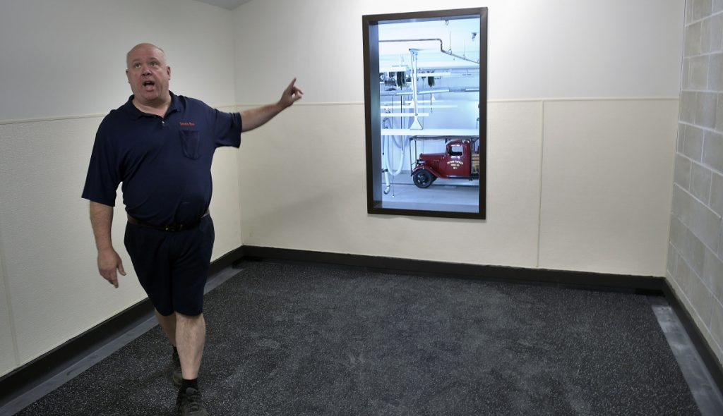 Winthrop Fire Chief Dan Brooks walks Thursday through the water proof training room on the second floor of the new Winthrop Fire Station.