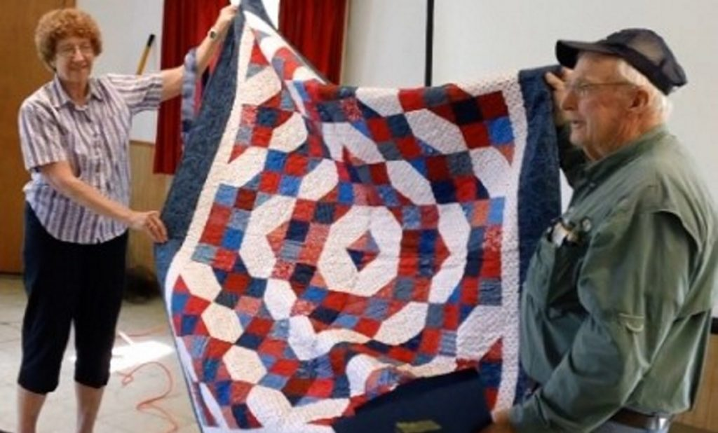 Jane Wilcox of the Maine Mountain Quilters of Farmington, left, recently presented a Quilt of Valor to Maj. Don Taylor during a meeting of the disabled veterans group called Back in the Maine Stream,