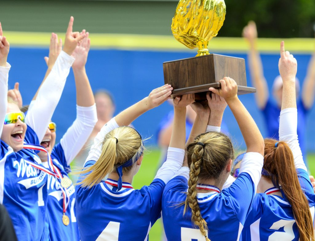 The Madison softball team celebrates after it defeated Narraguagus 7-3 in the Class C state title game Saturday at Bailey Field on the St. Joseph's College campus.