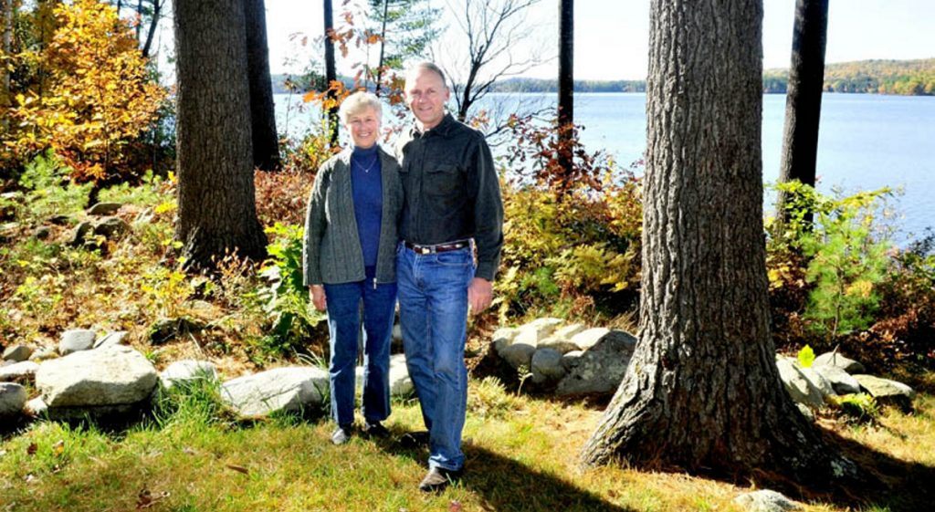 Phyllis and Lynn Matson stand beside a wooded buffer zone between their home and Long Pond in Rome in this Oct. 21, 2012, file photo. The Matsons, who were honored with a LakeSmart award at the time, have donated property for a public park on a triangle of land between Route 27 and West Road in Belgrade.