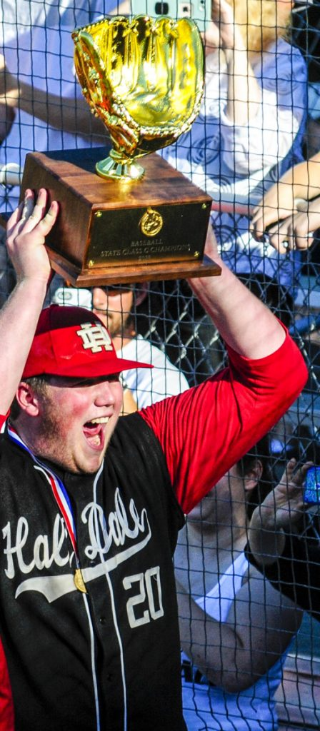 Hall-Dale pitcher Cole Lockhart celebrates with the Class C state championship trophy Saturday afternoon at St. Joseph's College.
