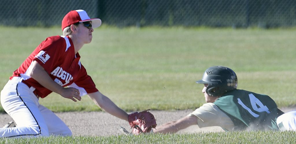 Augusta's Jacob Brown tags Bessey Motors' Brayden Bean at second during an American Legion game Tuesday in Augusta.