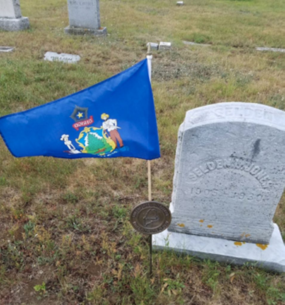 A brass plaque and flag holder, which had been placed on Officer Rufus Lishness's grave, has been stolen. This is a photo provided by Augusta police of a similar one placed at a gravesite of another Augusta police officer killed in the line of duty.