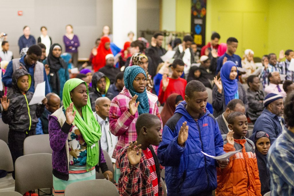 About 80 immigrants ages 7 to 22 became U.S. citizens March 10, 2016, in a naturalization ceremony at the Portland Public Library. Despite the end of the Trump administration's policy of separating families, concern remains among those who work with immigrants in Maine because the executive order also allows for the construction of detention facilities, if necessary, to hold families as they go through immigration proceedings, and seeks to override a law limiting the number of days children can stay in detention facilities.