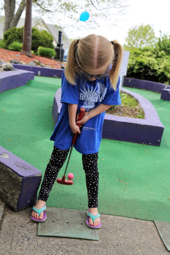 Ava Belknap tries her hand at backwards putting during the Putt 4 Cass event held May 19 at Gifford's Famous Ice Cream & Mini Golf.