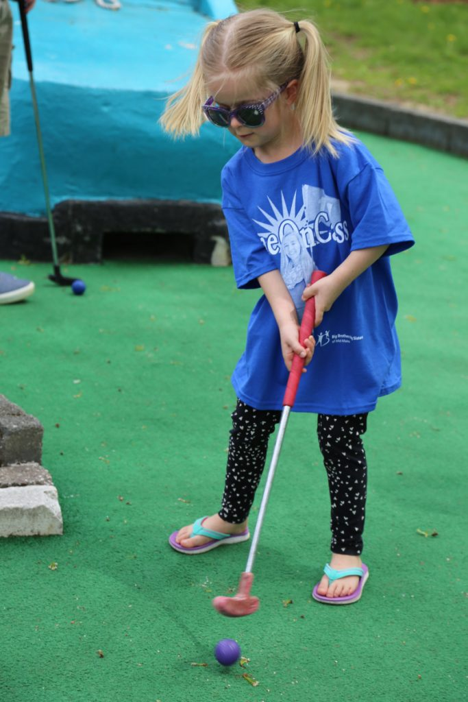 Peyton Belknap, takes her turn at Big Brothers Big Sisters of Mid-Maine's Putt 4 Cass event held May 19 at Gifford's Famous Ice Cream & Mini Golf..