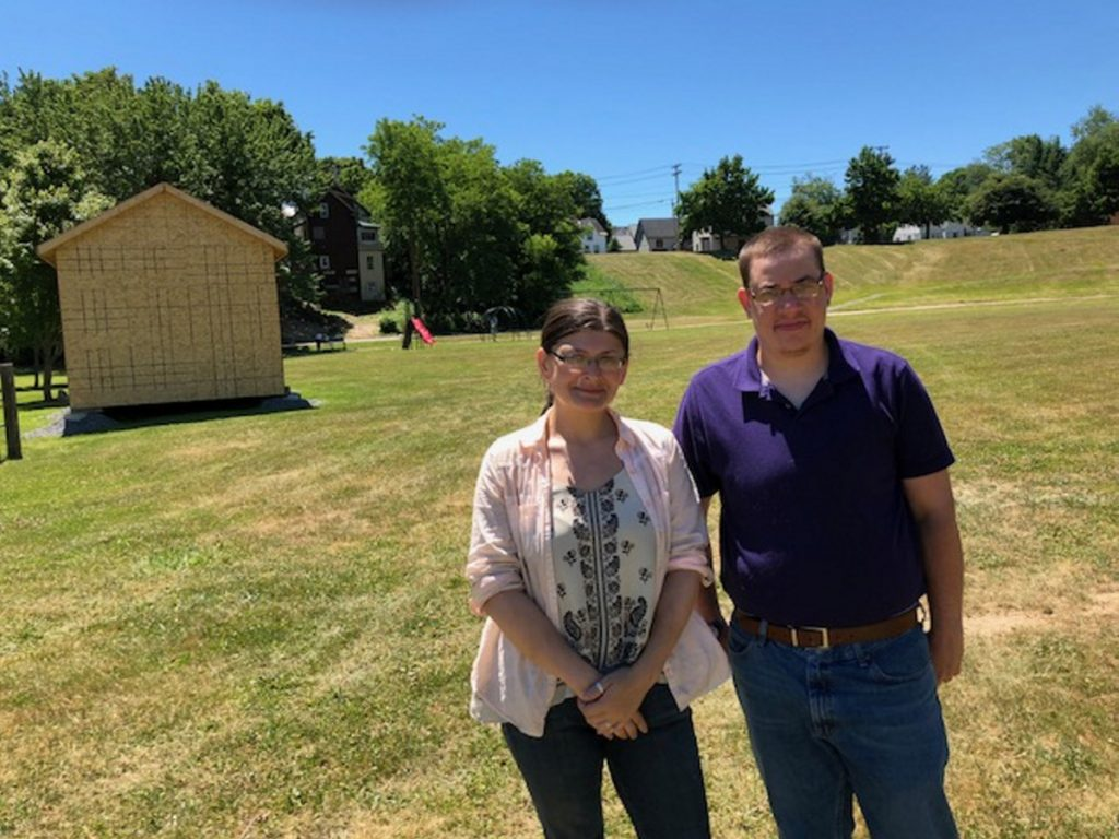 Jackie Dupont, chairwoman of the South End Neighborhood Association, and member Rien Finch lead a tour of Green Street Park on Friday. They hope to raise $20,000 to finish the first phase of the renovation of the park, which will include fitness stations.
