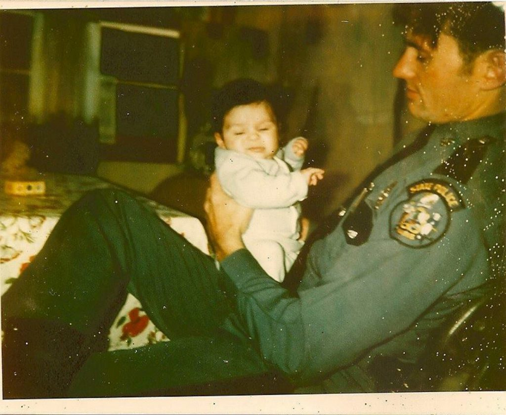 Maine State Trooper Thomas Merry holds his son, Ben, in 1980. Trooper Merry was killed weeks later setting up a roadblock on U.S. Route 2 in Palmyra.