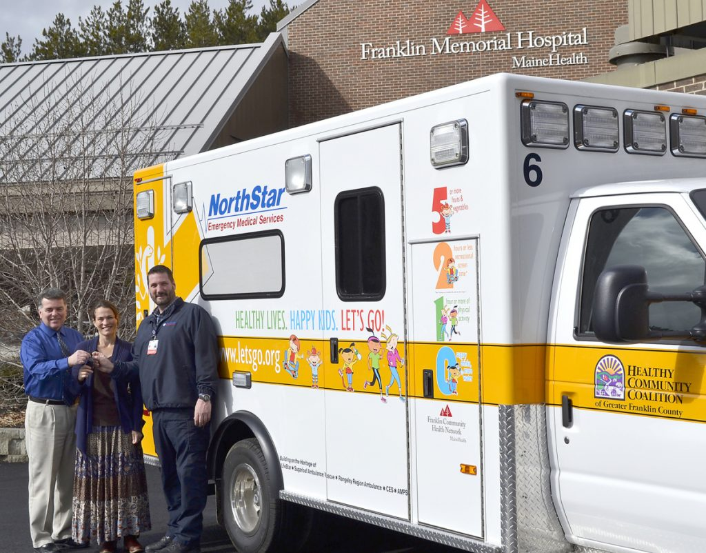 NorthStar EMS in Farmington unveiled its third health-theme painted ambulance on March 11, 2016, to the community. From left, are Gerald Cayer, executive vice president; Dr. Lorien Batt, lead physician, Franklin Health Pediatrics; and Mike Senecal, director of NorthStar ambulance. Franklin County commissioners will consider on Tuesday charging the ambulance service a fee for using county dispatch services.