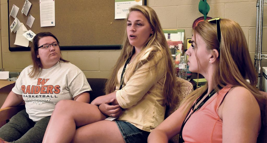 JMG high school students who aspire to go to college, from left, Emily Glidden of Winslow High School, Alisa Bonefant of Hall-Dale and Bradie Reynolds of Mt. Blue, discuss the week-long college level classes they took at Thomas College in Waterville on Thursday.