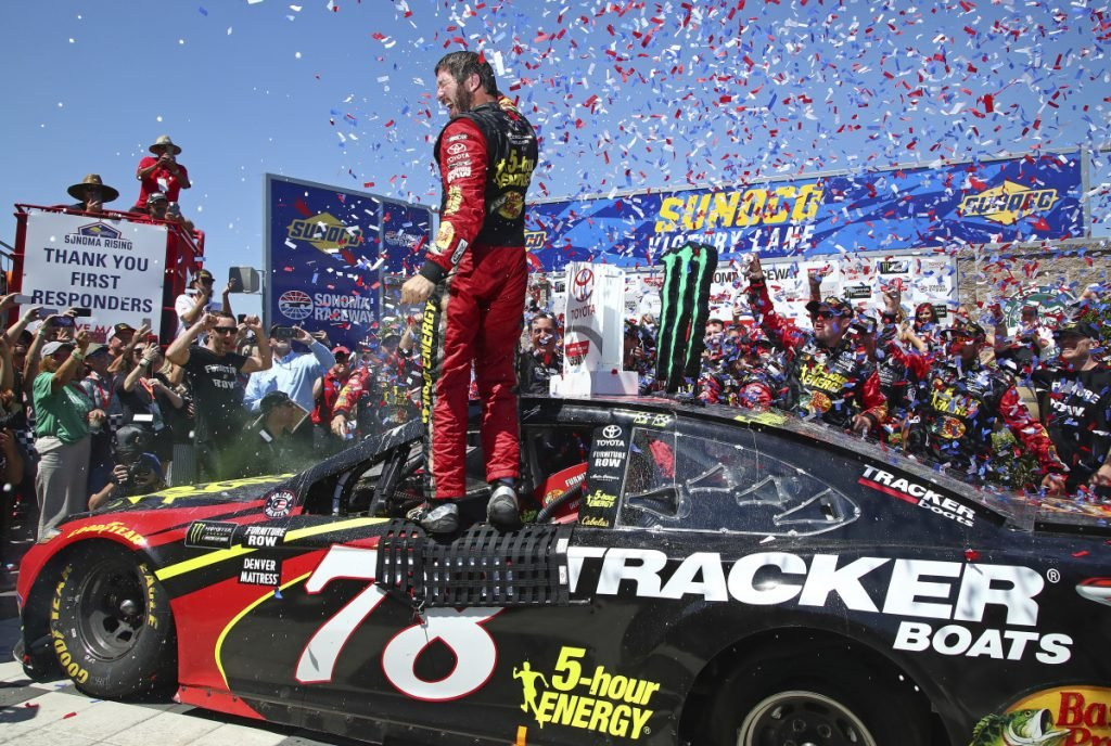 Martin Truex Jr. celebrates after winning a NASCAR Sprint Cup Series race Sunday in Sonoma, California.