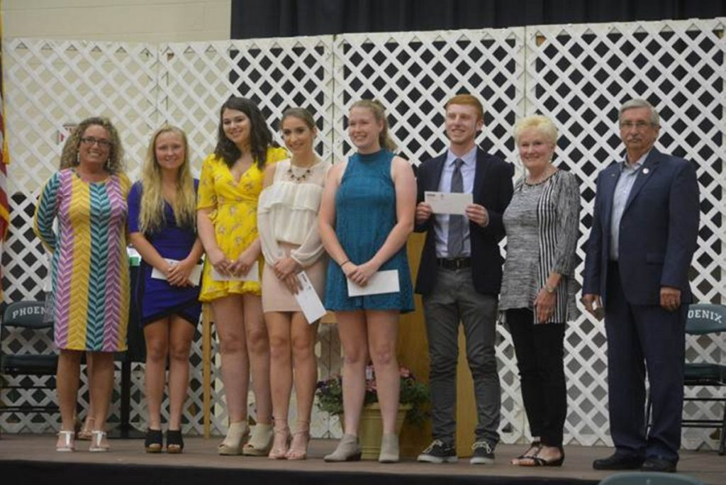 Five Spruce Mountain High School graduating seniors recently were awarded scholarships from OTIS Federal Credit Union. From left are Darice Dubreuil, vice president of Lending at the credit union; graduating Spruce Mountain High School seniors Morgan Dalton, Lauren Cornelio, Rylee Saunders, Hailee Perkins and Jordan Daigle, and Donna Labbe and Gary Desjardins, OTIS FCU Board of Directors.