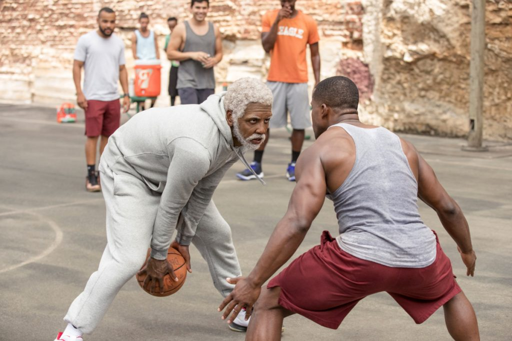 "This image released by Lionsgate shows Boston Celtics guard Kyrie Irving, left, portraying Uncle Drew in a scene from the comedy ""Uncle Drew."""