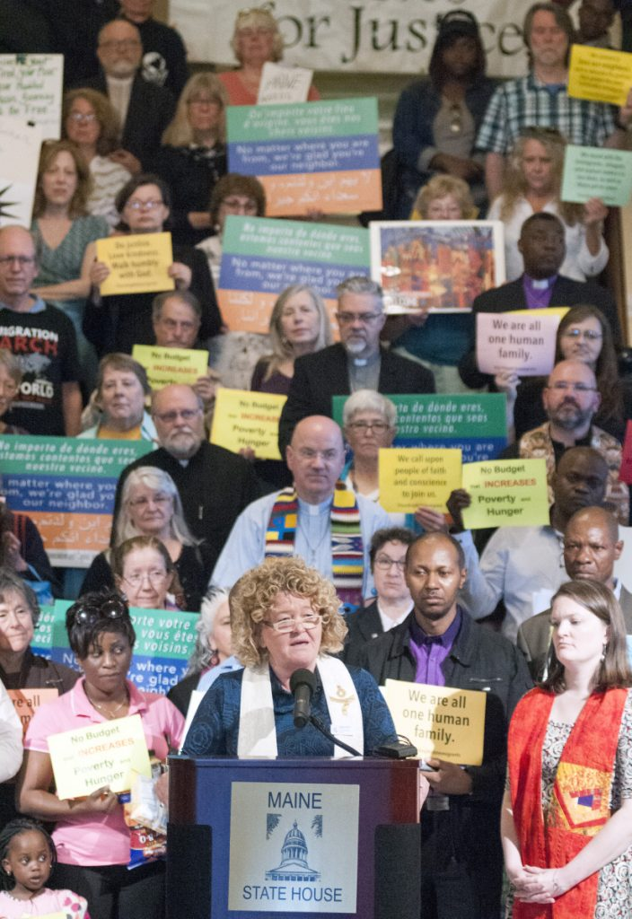 The Rev. Carie Johnsen, of the Unitarian Universalist Community Church in Augusta, speaks at a on June 7, 2017, rally about immigration led by religious leaders in the State House Hall of Flags in Augusta. Rallies in Augusta and Farmington this Saturday are part of a nationwide protest against Trump immigration policies.