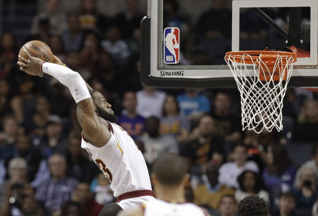 In this March 28 photo, Cleveland Cavaliers' LeBron James goes up to dunk against the Charlotte Hornets in Charlotte, North Carolina.