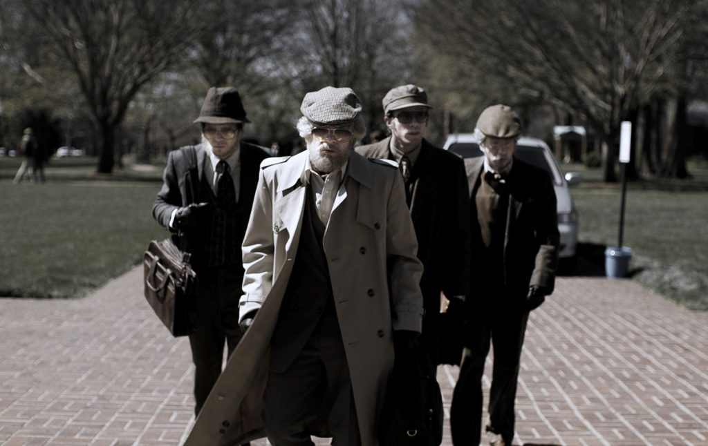 "From left, the ineptly disguised Jared Abrahamson, Evan Peters, Blake Jenner and Barry Keoghan in ""American Animals."""