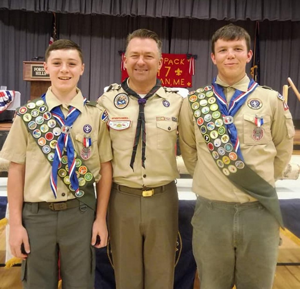 Pine Tree Council Scout Executive Eric Tarbox, center, with Eagle Scouts Parker Desjardins, left, and Hunter Cuddy, right.