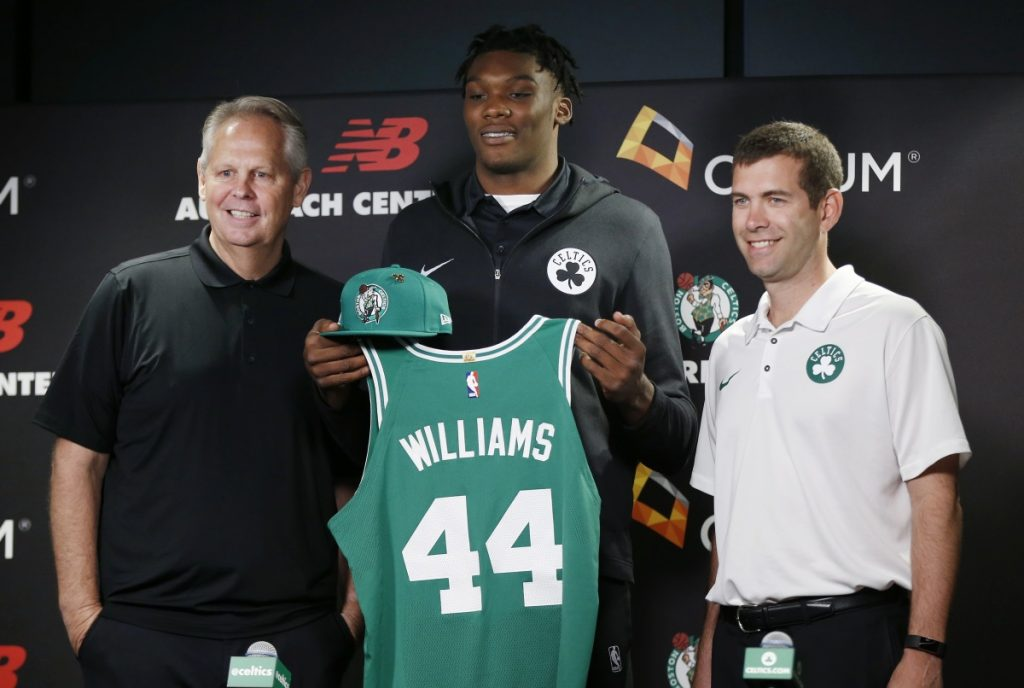 Boston Celtics draft pick Robert Williams, center, poses with general manager and President of Basketball Operations Danny Ainge, left, and head coach Brad Stevens during a news conference Friday in Boston.