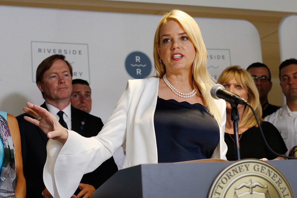 Florida Attorney General Pam Bondi, shown in May, was confronted by an impromptu demonstration Saturday by people who questioned Florida joining a lawsuit against the Affordable Care Act and Bondi's support of President Trump. Bondi has a national following as a contributor to Fox News.