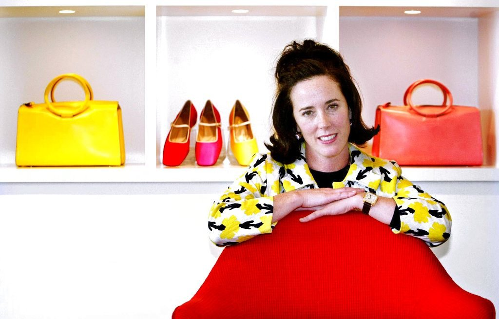 Designer Kate Spade poses with handbags and shoes from her next collection in New York in May, 2004.