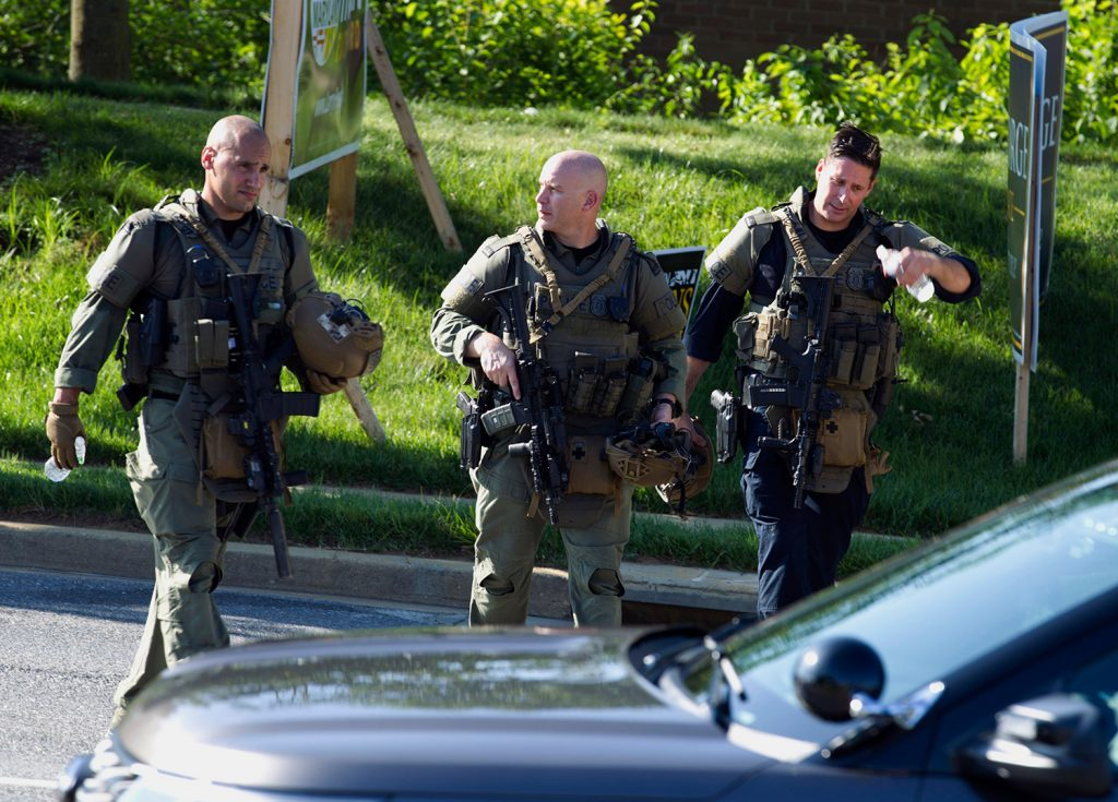 Police officers at the scene Thursday after multiple people were shot at the Capital Gazette newspaper office building in Annapolis, Md. Authorities were searching an apartment late Thursday tied to suspect Jarrod W. Ramos, 38.