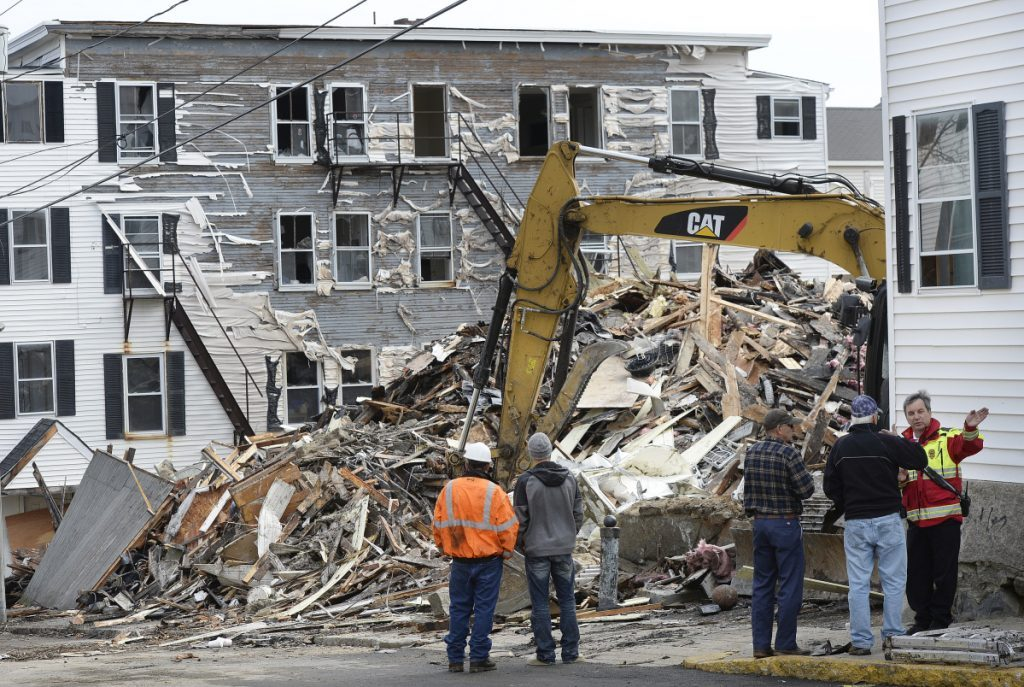 Rubble is all that is left of an apartment building on Hill Street in Biddeford after a fire in April that killed one man. An operator of a sober house had filed a federal complaint after the city deemed the building inappropriate for use as a sober house because it had no sprinkler system. The complaint has been withdrawn.