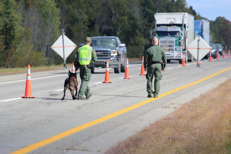 U.S. Border Patrol agents operate an immigration checkpoint in June on I-95 in Penobscot County.
