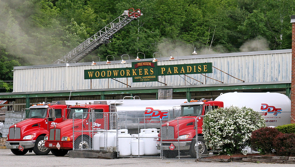 Smoke and steam rise Saturday morning from the Woodworkers Paradise building on Route 2, where Rumford Fire Chief Chris Reed said flames erupted in a rented marijuana grow room.
