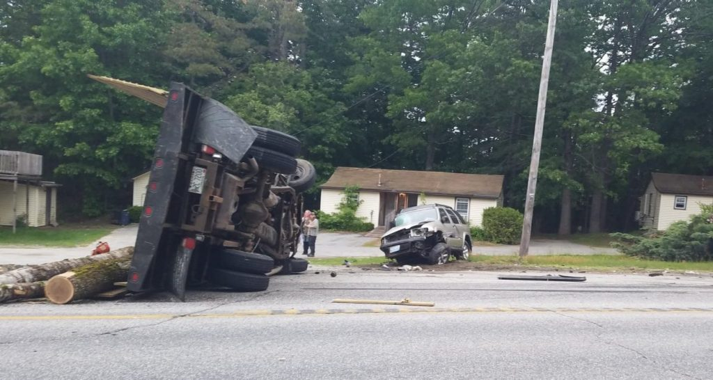A crash involving a logging truck shut down part of Route 302 in Windham on Tuesday evening.