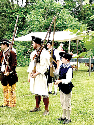 Historical reenactors portray a typical day in an 18th century encampment.  Contributed photo