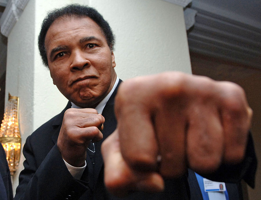 Muhammad Ali poses at the World Economic Forum in Davos, Switzerland, in  2005. He refused to report for induction into the U.S. military during the Vietnam War.