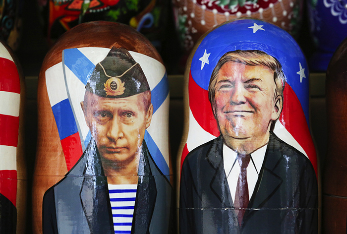 Souvenir matryoshka dolls depicting Vladimir Putin and Donald Trump are on display at a tourist stall in St. Petersburg, Russia.