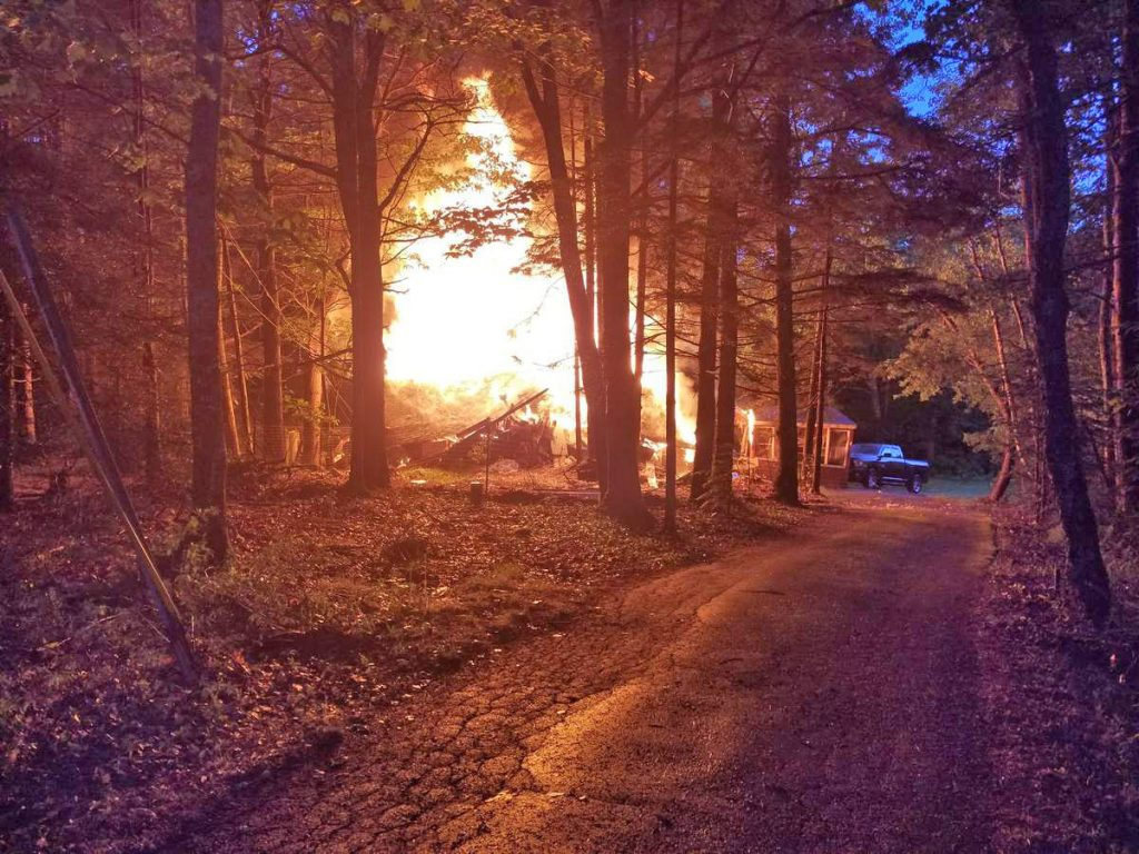 Fire engulfs a home at 1838 Dutch Neck Road in Waldoboro Thursday evening.