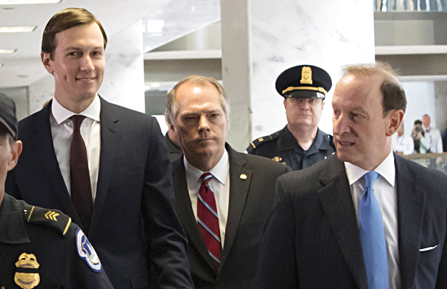 James A. Wolfe, the longtime director of security for the Senate Intelligence Committee, center, walks with Jared Kushner, left, after a closed-door interview with Senate Intelligence Committee investigators on July 24, 2017.   J. Abbe Lowell, a well-known Washington criminal defense attorney, is at right.