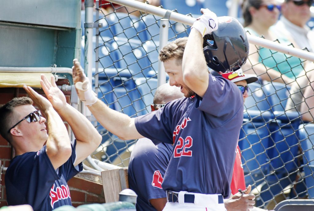 Staff photo by Jill Brady Portland's Danny Mars, left, congratulates Jantzen Witte after Witte's solo home run in the first inning of the Sea Dogs' 4-3 loss Sunday at Hadlock Field.