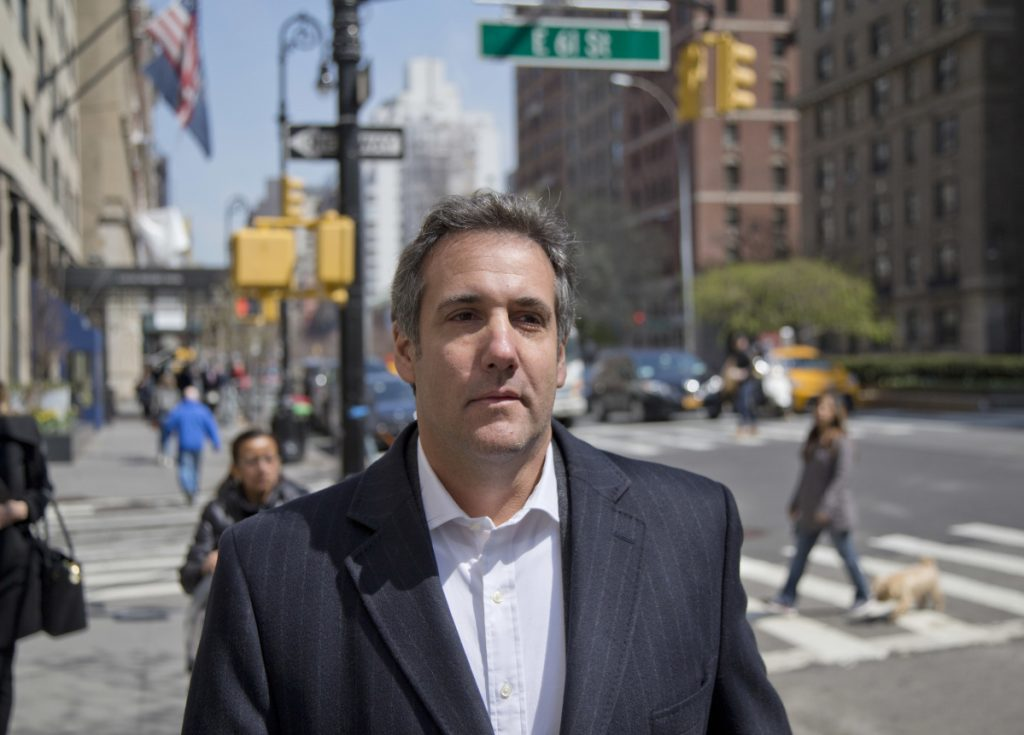 """Attorney Michael Cohen walks down the sidewalk in New York. Cohen, President Trump's longtime personal lawyer who is under investigation by federal prosecutors in New York, said he planned on putting """"family and country first"""" in his dealings with the Mueller investigation."""