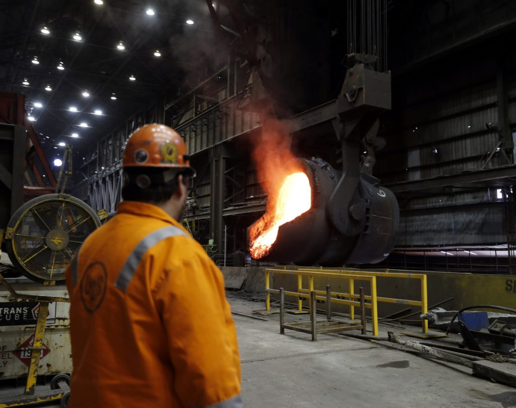 FILE- In this Thursday, June 28, 2018, file photo senior melt operator Randy Feltmeyer watches a giant ladle as it backs away after pouring its contents of red-hot iron into a vessel in the basic oxygen furnace as part of the process of producing steel at the U.S. Steel Granite City Works facility in Granite City, Ill. On Monday, July 2, the Institute for Supply Management, a trade group of purchasing managers, issues its index of manufacturing activity for June.