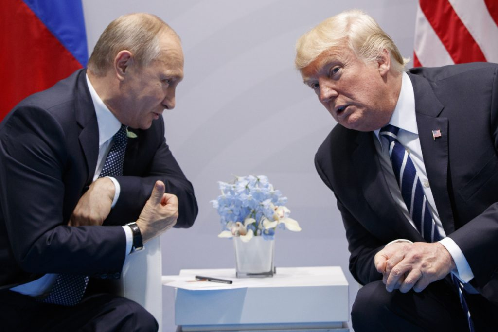 FILE - In this Friday, July 7, 2017, file photo U.S. President Donald Trump meets with Russian President Vladimir Putin at the G-20 Summit in Hamburg.