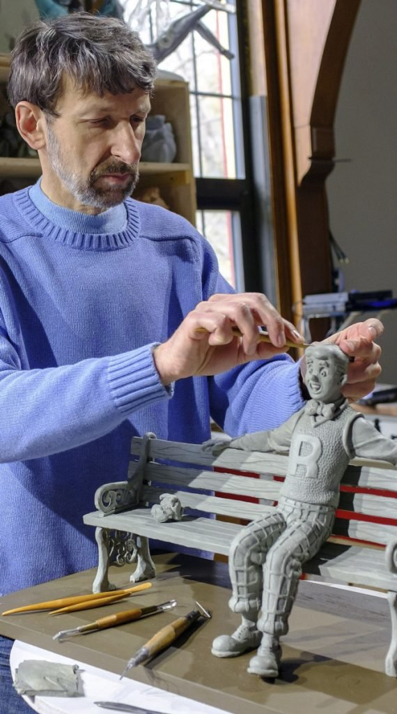 Sculptor Valery Mahuchy works on a clay model for his bronze statue of Archie in April 2017 at his studio in Bethlehem, N.H.