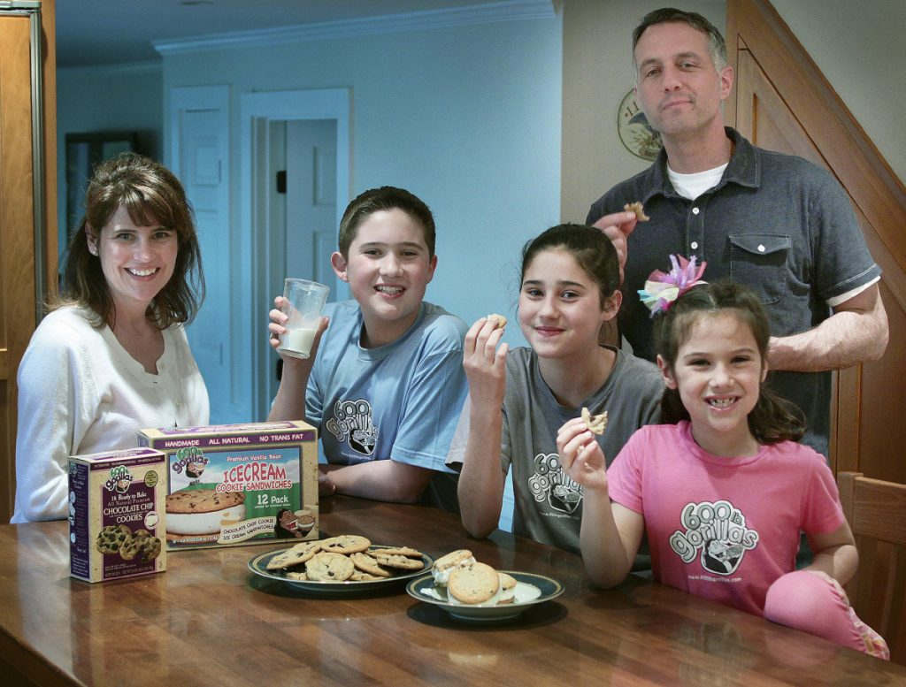 Paula, left, and husband Chris White, right, pose with their children and some of their 600 lb Gorillas frozen ice cream sandwiches and cookies in Duxbury, Mass., in 2011.