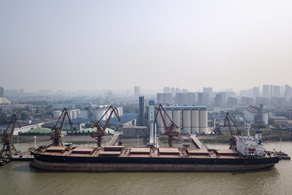 A ship unloads grain in Nantong, China. Farmers in the American Midwest fear a tariff battle will cost them access to China's lucrative markets.