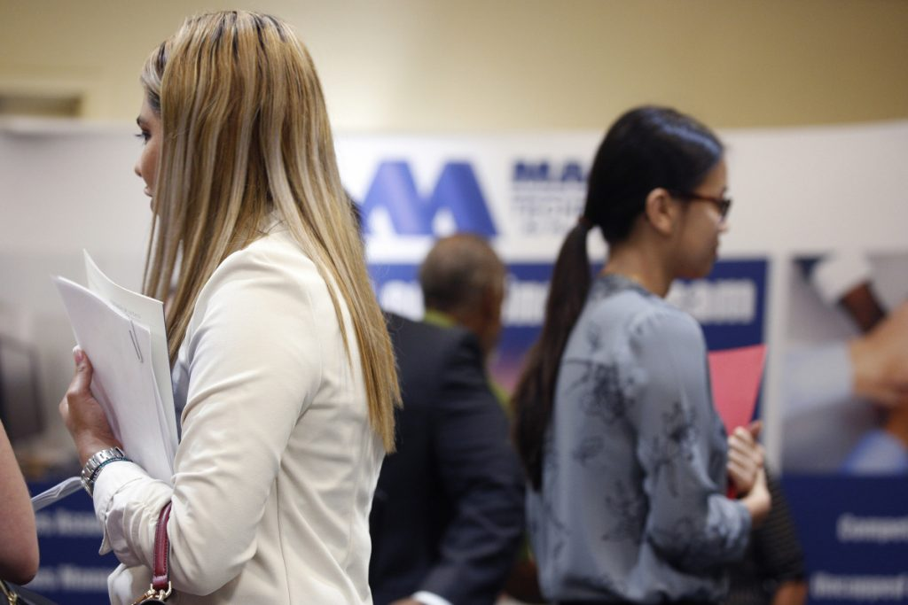 Job seekers hold resumes while waiting to speak with representatives during a National Career Fairs event in Tampa, Florida, on May 23, 2018. MUST CREDIT: Bloomberg/Luke Sharrett.