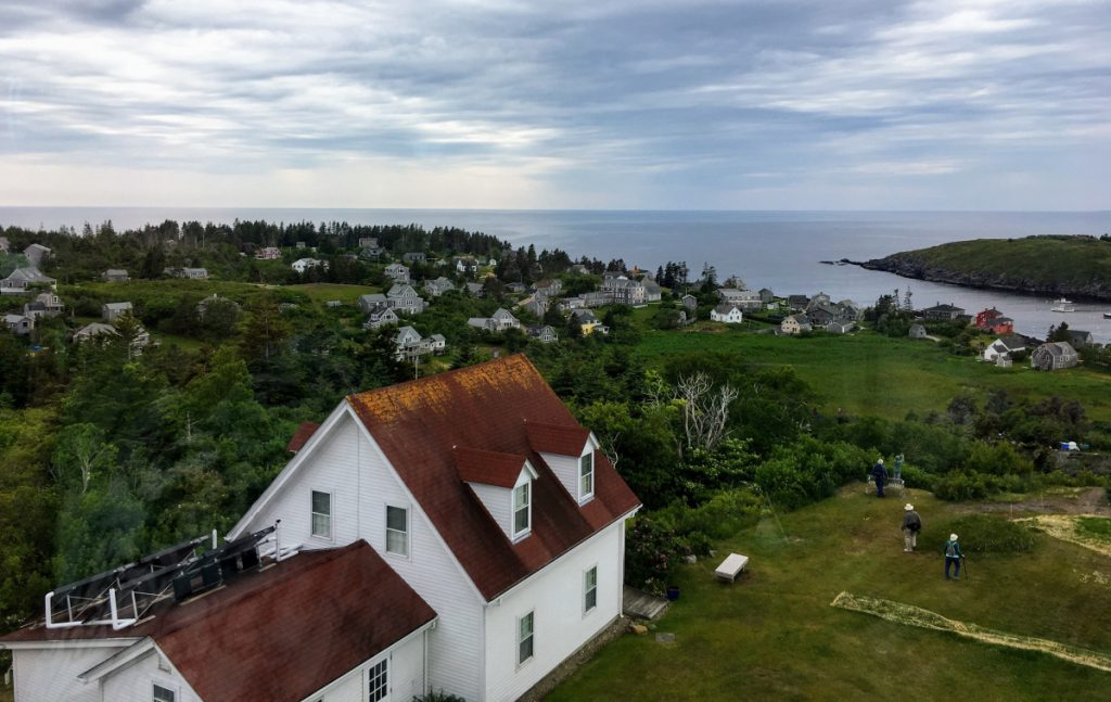 The view from the lighthouse looks down on the Monhegan Museum. The museum opens the lighthouse to the public occasionally.
