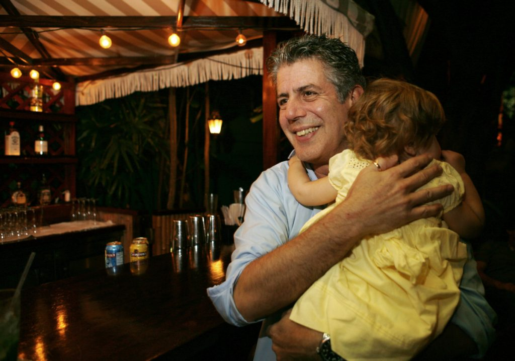 Anthony Bourdain holds his daughter Ariane in Miami Beach in 2008. Bourdain was worth $1.2 million when he died last month. Most of the estate has been left to his daughter, who is now 11.