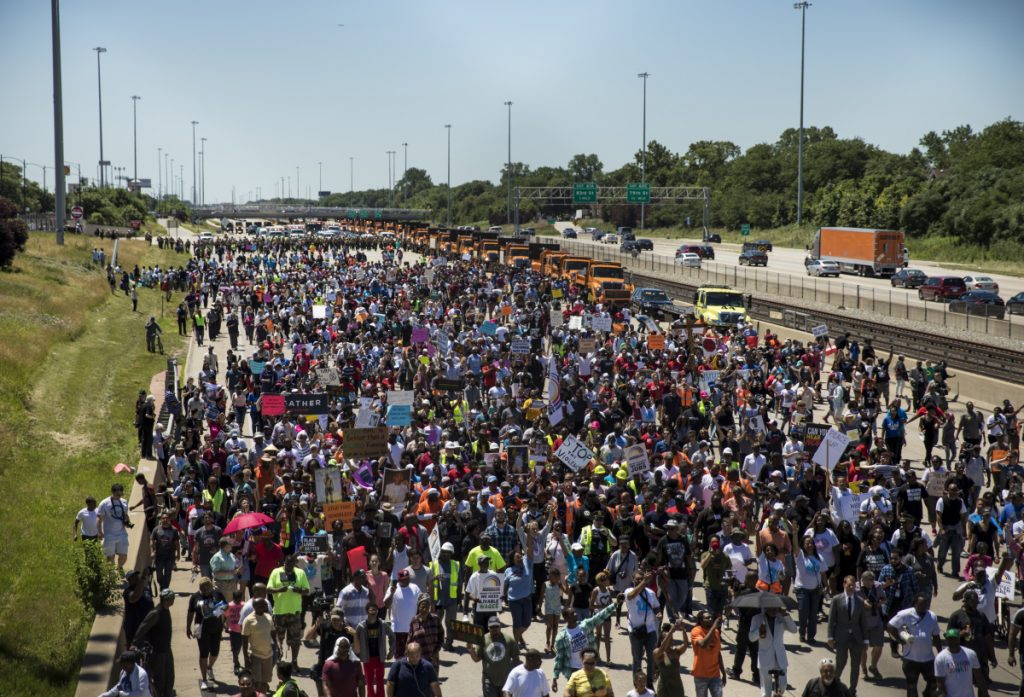 Thousands of anti-violence protesters pour into the inbound lanes of Interstate 94, known as the Dan Ryan Expressway, on Saturday in Chicago.