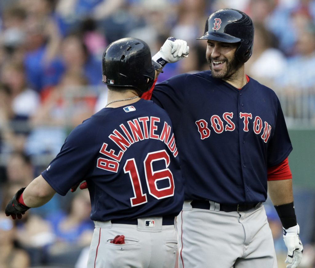 Boston Red Sox designated hitter J.D. Martinez, right, was named to the American League starting lineup for the All-Star game. Andrew Benintendi, meanwhile, is one of five players on the final vote ballot.